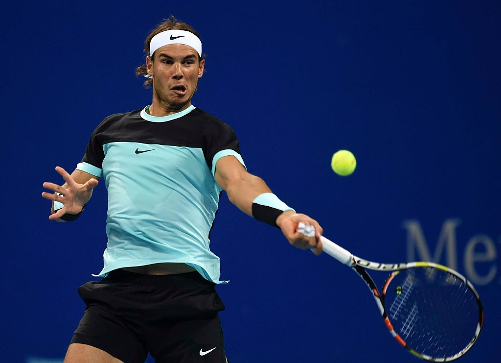 BEIJING, CHINA - OCTOBER 07:  (CHINA OUT) Rafael Nadal of Spain returns a shot against Vasek Pospisil of Canada during the Men's singles Second round match on day five of the 2015 China Open at the China National Tennis Centre on October 7, 2015 in Beijing, China.  (Photo by Hao Yi/Beijing Youth Daily/VCG via Getty Images, BA)