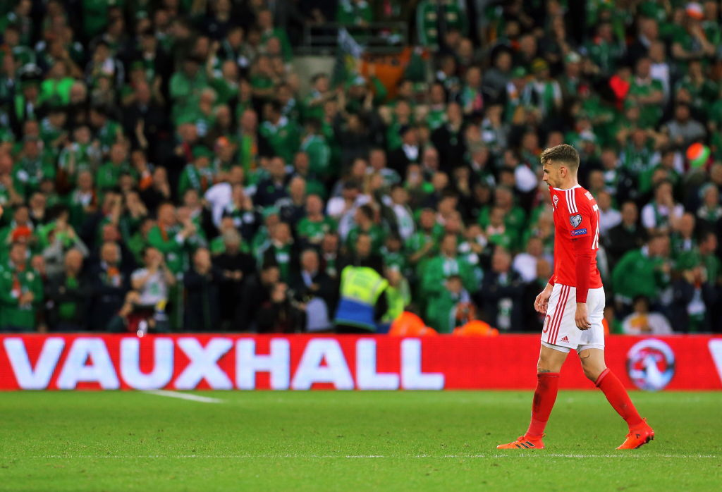 CARDIFF, WALES - OCTOBER 09: A disappointed Aaron Ramsey of Wales walks infront of the cheering Ireland supporters during the FIFA World Cup Qualifier Group D match between Wales and Republic of Ireland at The Cardiff City Stadium on October 09, 2017 in Cardiff, Wales. (Photo by Athena Pictures/Getty Images, BA)