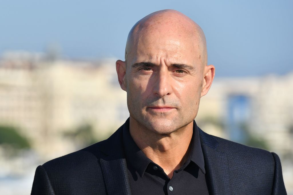 British actor Mark Strong, cast from the thriller tv series 'Deep state', poses for a photograph during the MIPCOM trade show (standing for International Market of Communications Programmes) in Cannes, southern France, on October 16, 2017. / AFP PHOTO / YANN COATSALIOU (Photo credit should read YANN COATSALIOU/AFP/Getty Images, BA)