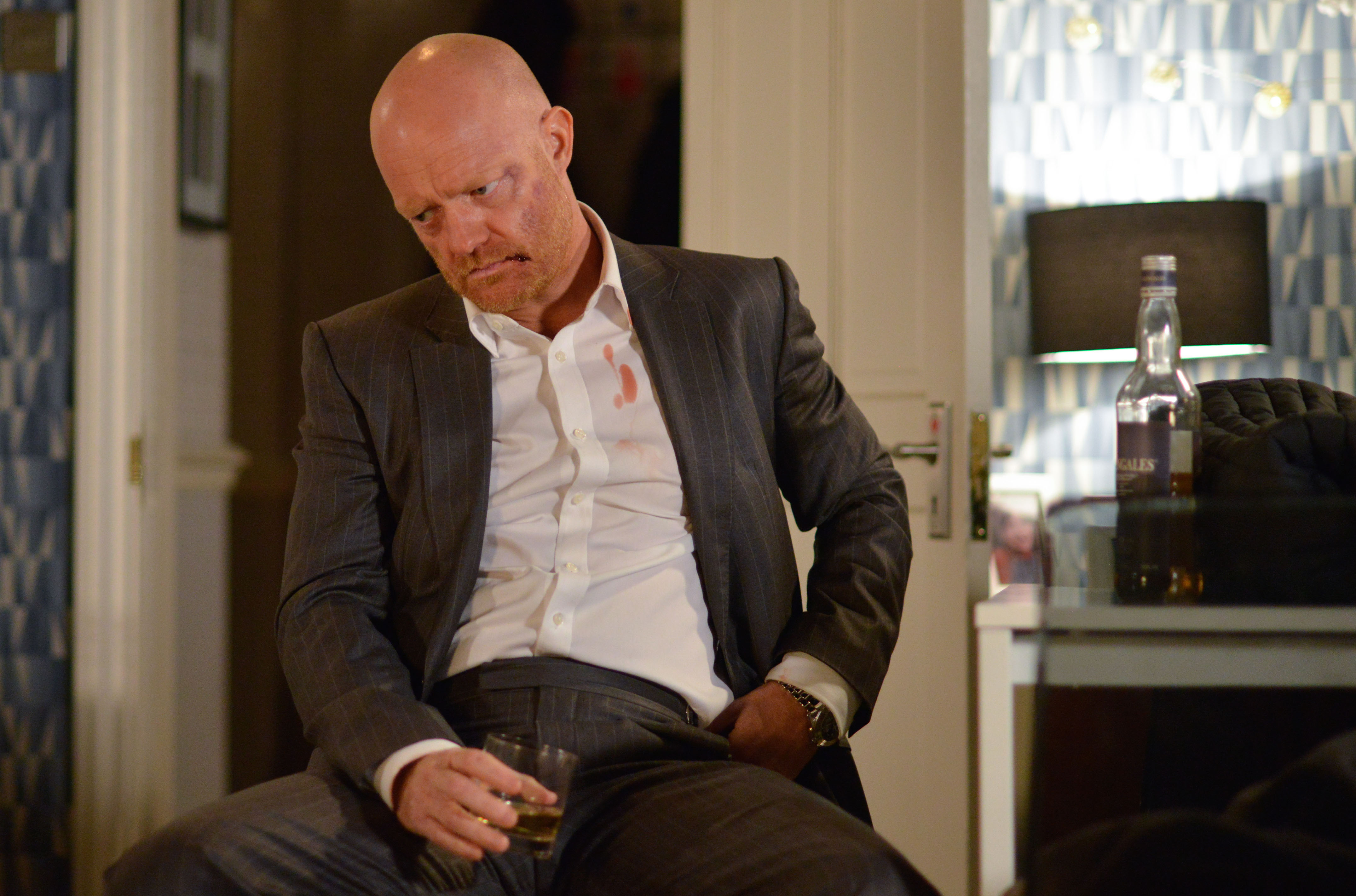 WARNING: Embargoed for publication until 00:00:01 on 08/12/2017 - Programme Name: EastEnders - October-December 2017 - TX: 07/12/2017 - Episode: EastEnders - October-December 2017 - 5611 (No. 5611) - Picture Shows: Max pours himself a drink while Jack, Lauren and Abi try to understand what he's done. Max Branning (JAKE WOOD) - (C) BBC - Photographer: Kieron McCarron