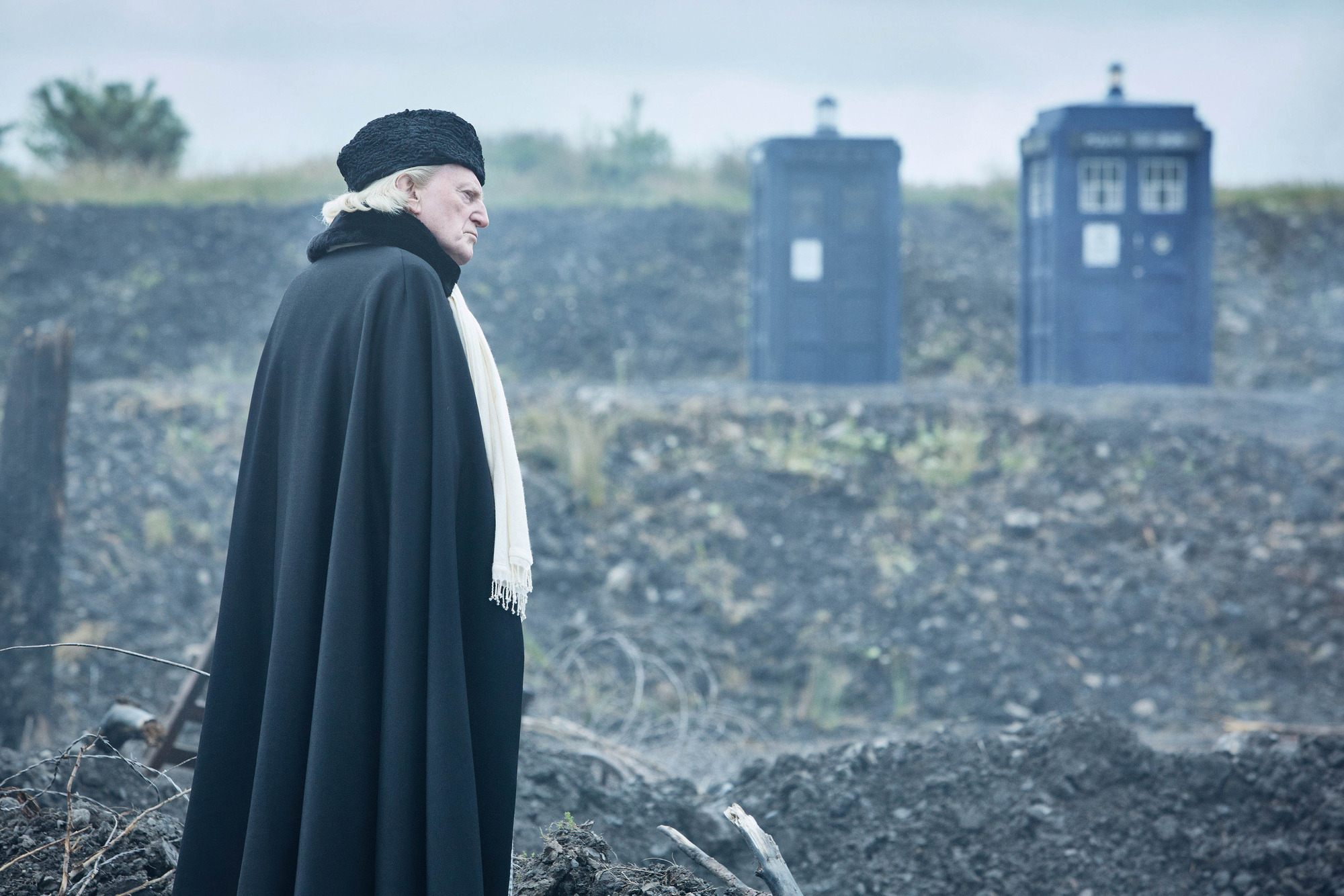 David Bradley as the First Doctor in Doctor Who with two Tardises in the background