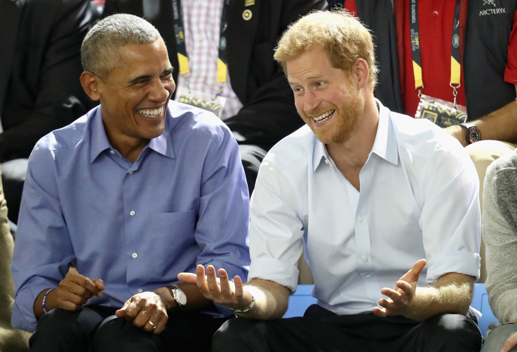 TORONTO, ON - SEPTEMBER 29:  Former U.S. President Barack Obama and Prince Harry share a joke as they watch wheelchair baskeball on day 7 of the Invictus Games 2017 on September 29, 2017 in Toronto, Canada  (Photo by Chris Jackson/Getty Images for the Invictus Games Foundation)