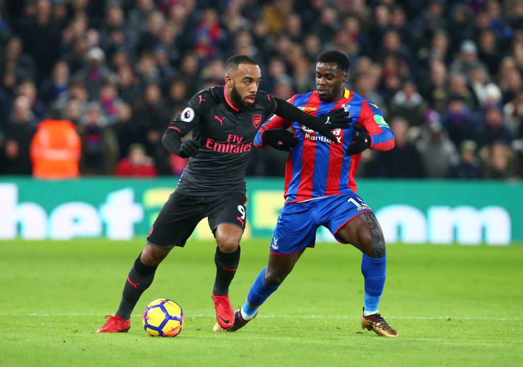 Arsenal's Alexandre Lacazette holds of Crystal Palace's Jeffrey Schlupp during Premier League  match between Crystal Palace and Arsenal at Selhurst Park Stadium, London,  England 28 Dec 2017. (Photo by Kieran Galvin/NurPhoto via Getty Images)