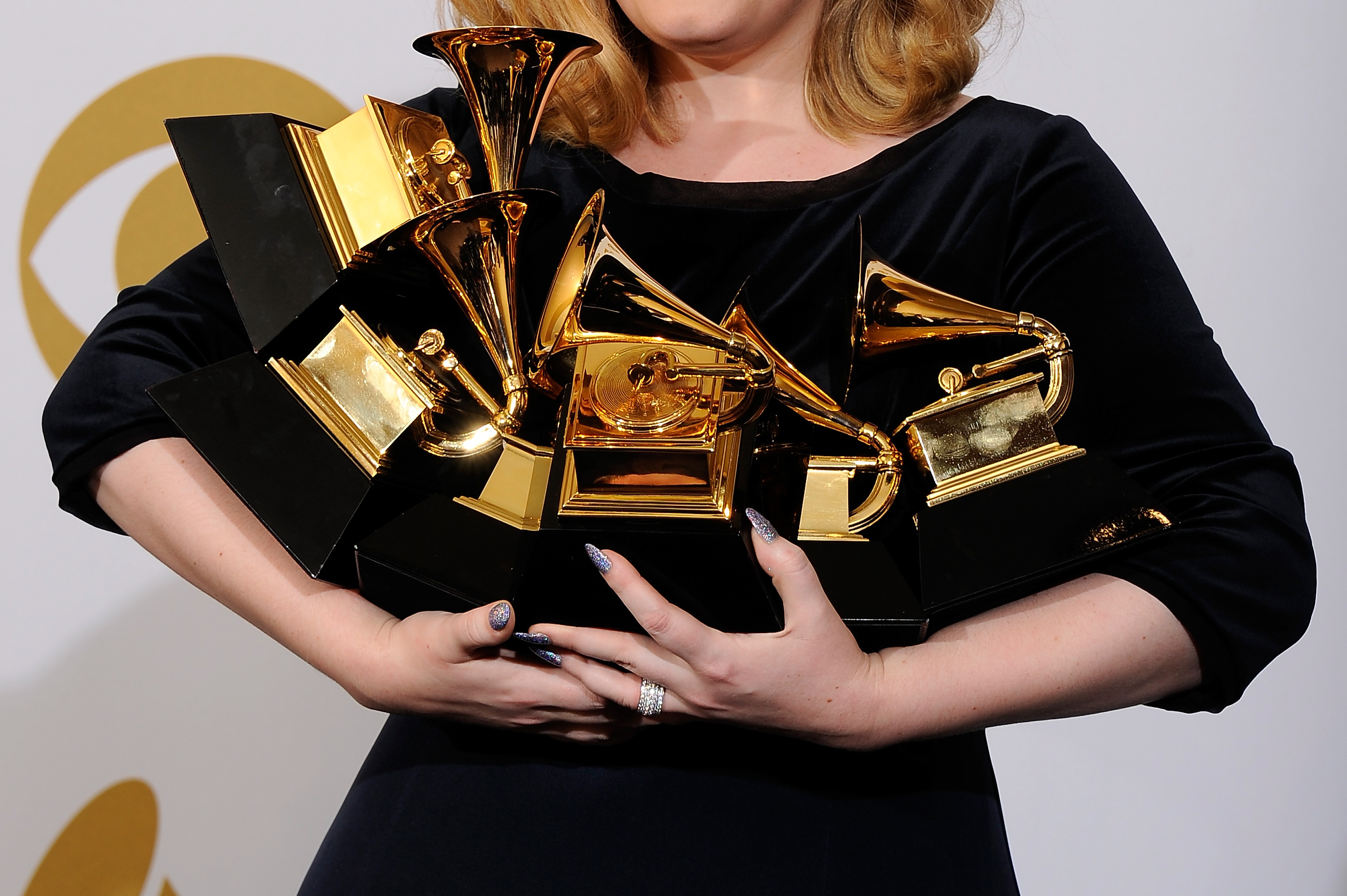 """LOS ANGELES, CA - FEBRUARY 12:  Singer Adele, winner of the GRAMMYs for Record of the Year for """"Rolling In The Deep"""", Album of the Year for """"21"""", Song of the Year for """"Rolling In The Deep"""", Best Pop Solo Performance for """"Someone Like You"""", Best Pop Vocal Album for """"21"""" and Best Short Form Music Video for """"Rolling In The Deep"""", poses in the press room at the 54th Annual GRAMMY Awards at Staples Center on February 12, 2012 in Los Angeles, California.  (Photo by Kevork Djansezian/Getty Images)"""