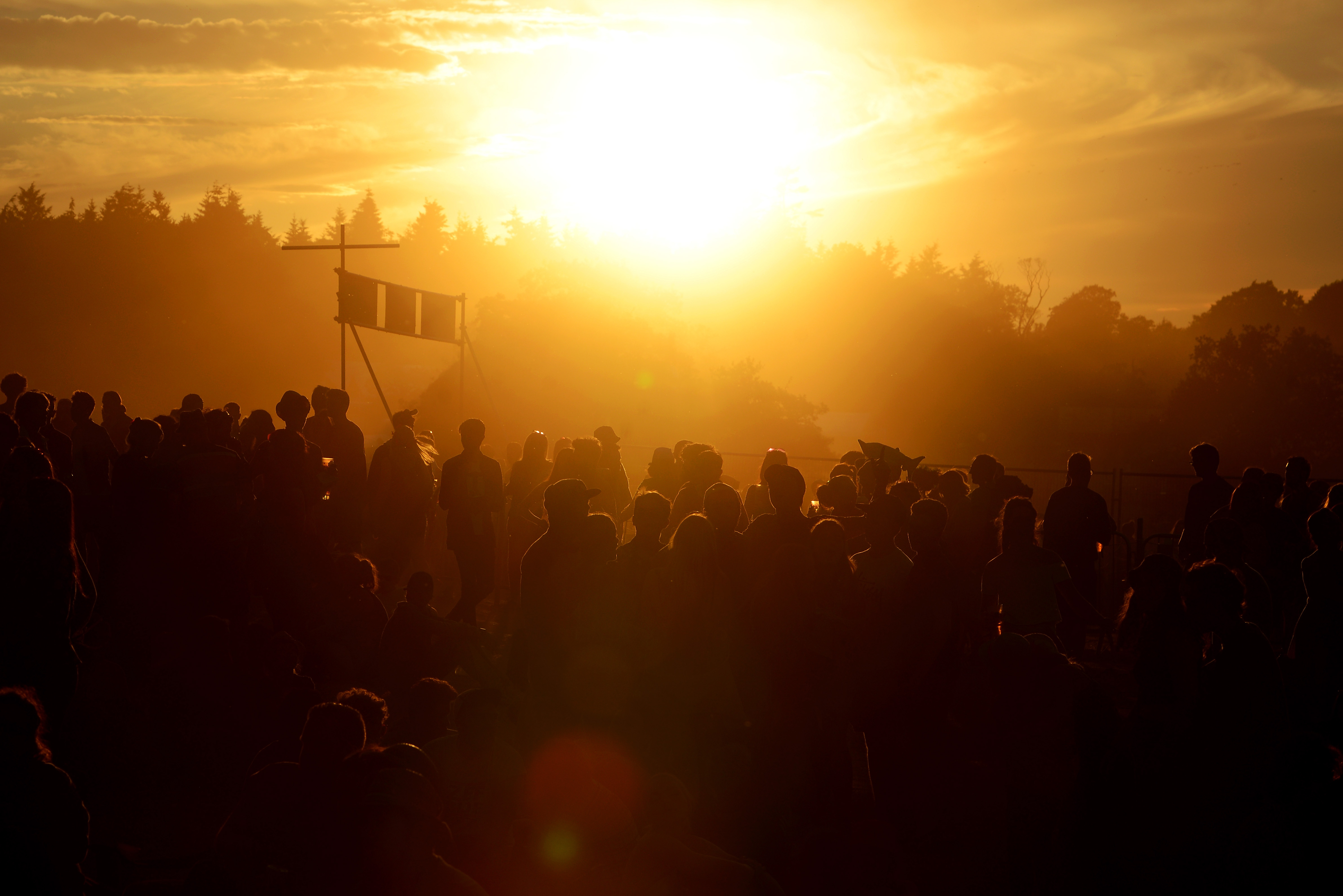 SOUTHWOLD, ENGLAND - JULY 19: The sun sets on day 4 of Latitude Festival at Henham Park Estate on July 19, 2015 in Southwold, England. (Photo by Matthew Baker/WireImage)