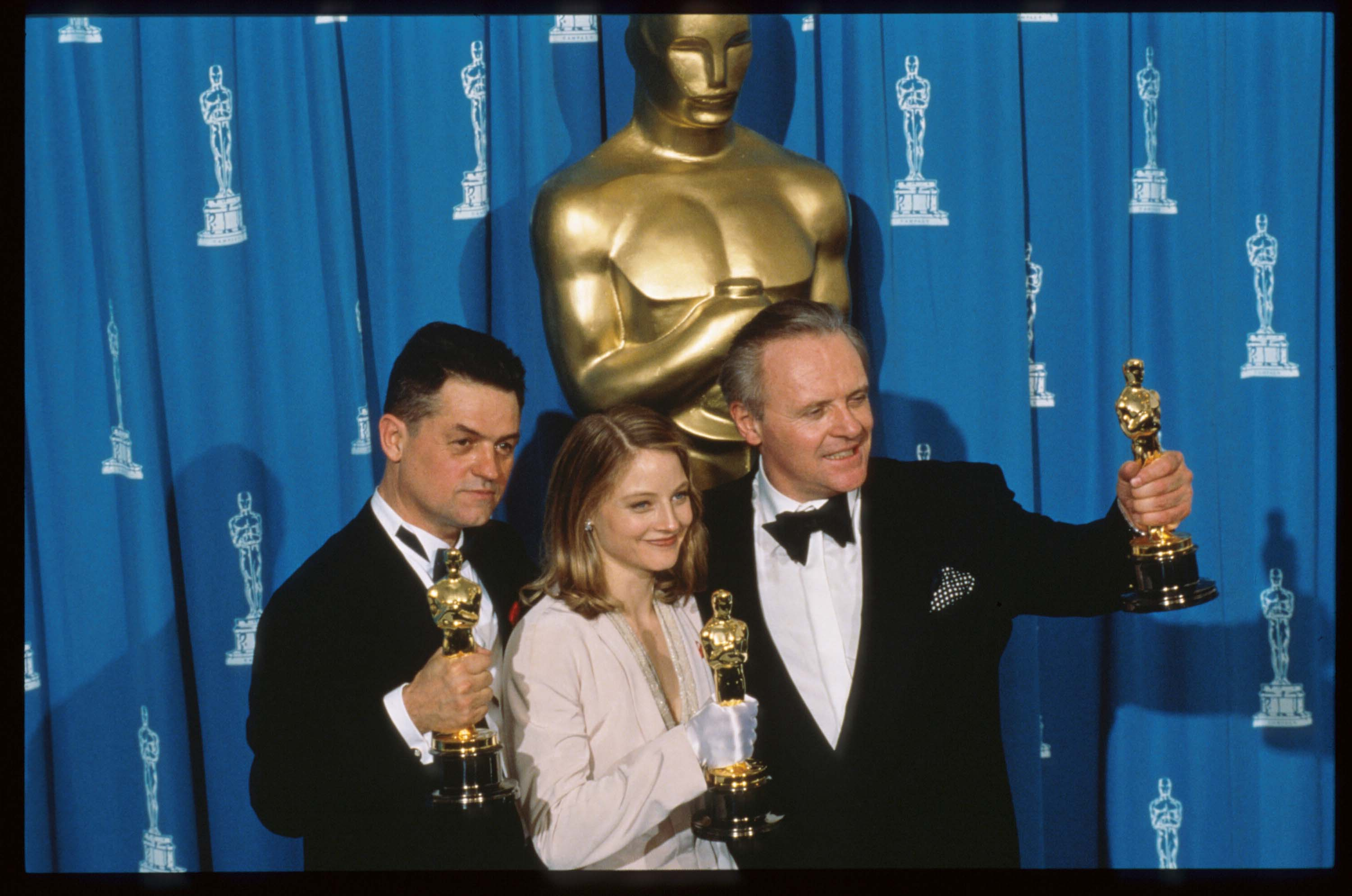 Anthony Hopkins, Jodie Foster and Jonathan Demme with their Oscars for Silence of the Lambs in 1992 (Getty, EH)