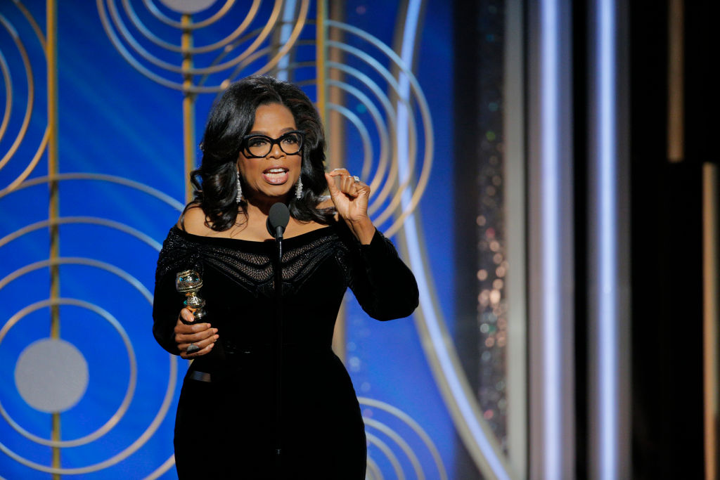 BEVERLY HILLS, CA - JANUARY 07:  In this handout photo provided by NBCUniversal, Oprah Winfrey accepts the 2018 Cecil B. DeMille Award   speaks onstage during the 75th Annual Golden Globe Awards at The Beverly Hilton Hotel on January 7, 2018 in Beverly Hills, California.  (Photo by Paul Drinkwater/NBCUniversal via Getty Images, BA)