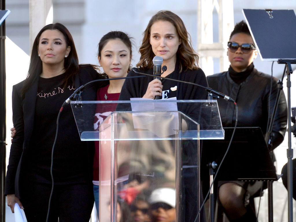 LOS ANGELES, CA - JANUARY 20:  (L-R) Actors Eva Longoria, Constance Wu and Natalie Portman speak during the Women's March Los Angeles 2018 on January 20, 2018 in Los Angeles, California.  (Photo by Chelsea Guglielmino/Getty Images, BA)