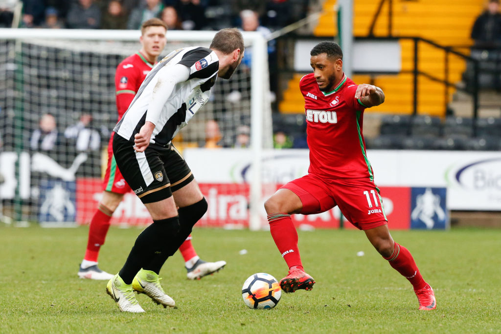 NOTTINGHAM, ENGLAND - JANUARY 27: Nicky Hunt of Notts County challenges Luciano Narsingh of Swansea City during The Emirates FA Cup match between Notts County and Swansea City at Meadow Lane on January 27, 2018 in Nottingham, England. (Photo by Athena Pictures/Getty Images)