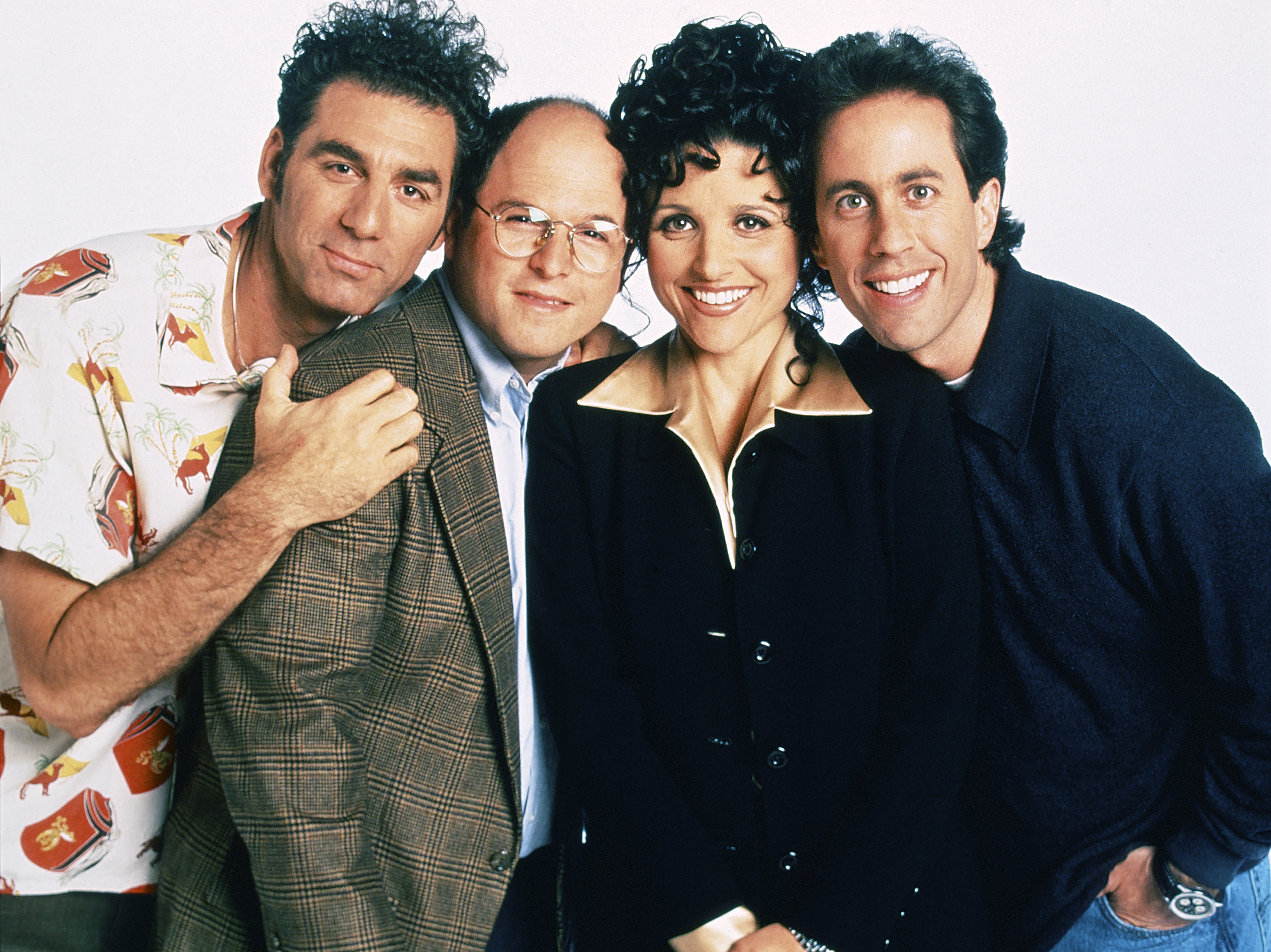 Cast of Seinfeld in potrait image.