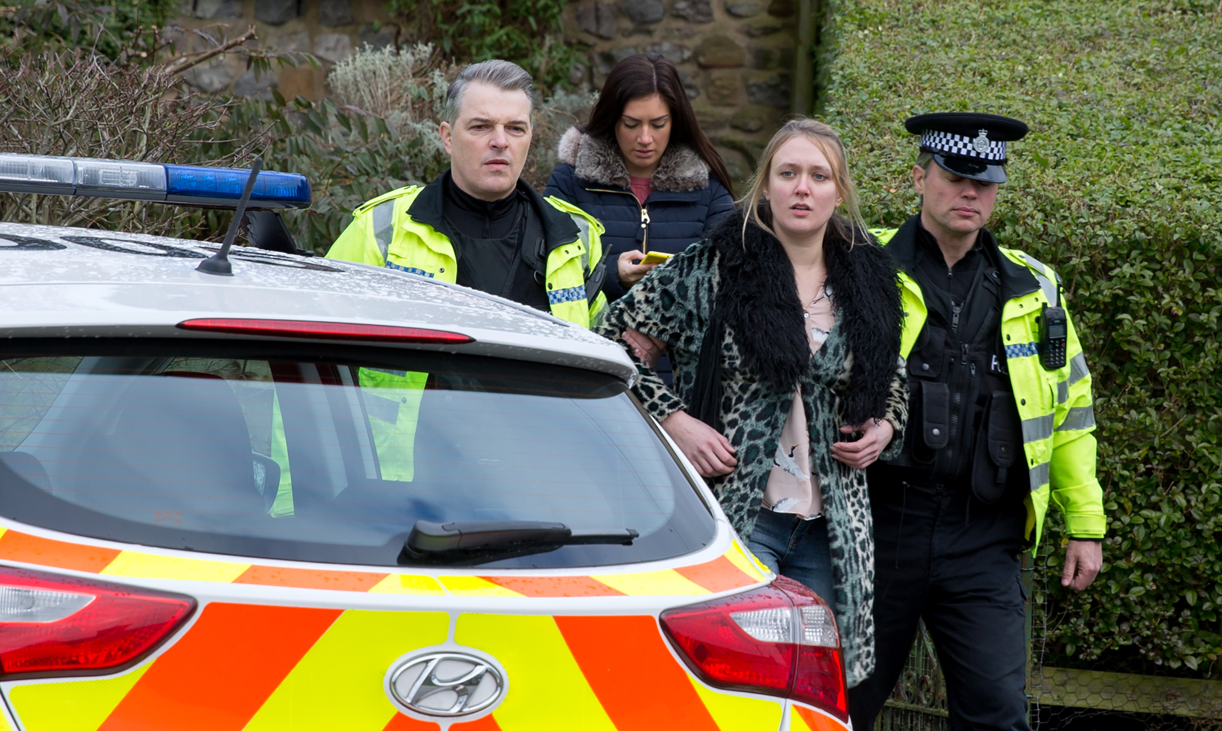FROM ITV   STRICT EMBARGO  Print media - No Use Before Tuesday 27 February 2018 Online Media -  No Use Before 0700hrs Tuesday 27 February 2018  Emmerdale - Ep 8091  Friday 9th March 2018   The police arrive to arrest Rebecca White [EMILY HEAD] for burglary and attempted assault at Home Farm.   Picture contact - david.crook@itv.com  Photographer - Amy Brammall  This photograph is (C) ITV Plc and can only be reproduced for editorial purposes directly in connection with the programme or event mentioned above, or ITV plc. Once made available by ITV plc Picture Desk, this photograph can be reproduced once only up until the transmission [TX] date and no reproduction fee will be charged. Any subsequent usage may incur a fee. This photograph must not be manipulated [excluding basic cropping] in a manner which alters the visual appearance of the person photographed deemed detrimental or inappropriate by ITV plc Picture Desk. This photograph must not be syndicated to any other company, publication or website, or permanently archived, without the express written permission of ITV Plc Picture Desk. Full Terms and conditions are available on the website www.itvpictures.com
