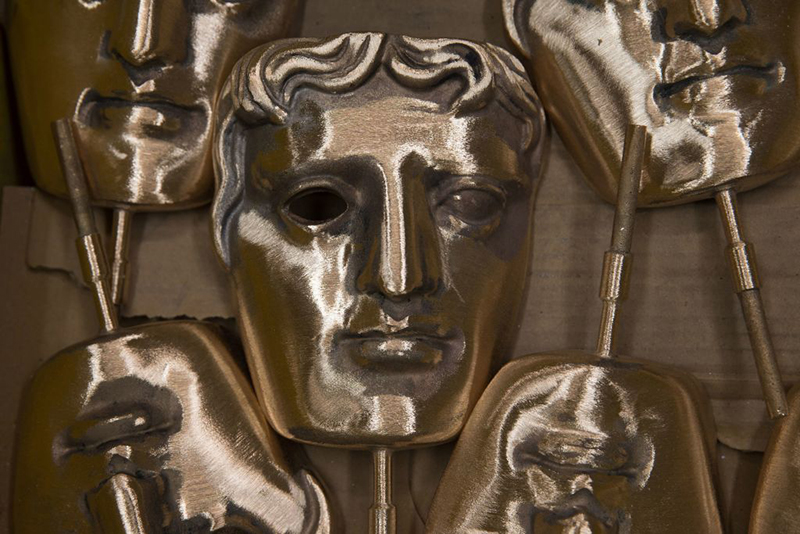 Polished BAFTA (British Academy of Film and Television Arts) masks sit in a box during a photocall at the New Pro Foundries, west of London on January 31, 2017. 