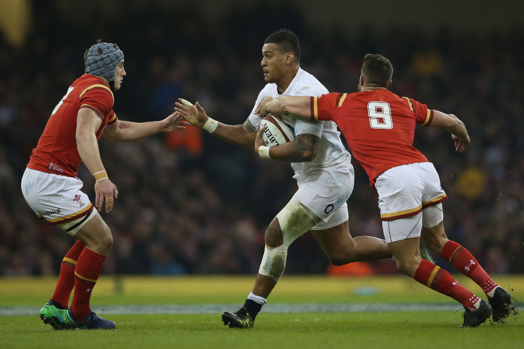 CARDIFF, WALES - FEBRUARY 11: Nathan Hughes of England is tackled by Rhys Webb of Wales during the RBS Six Nations match between Wales and England at the Principality Stadium on February 11, 2017 in Cardiff, Wales. (Photo by Steve Bardens - RFU/The RFU Collection via Getty Images)