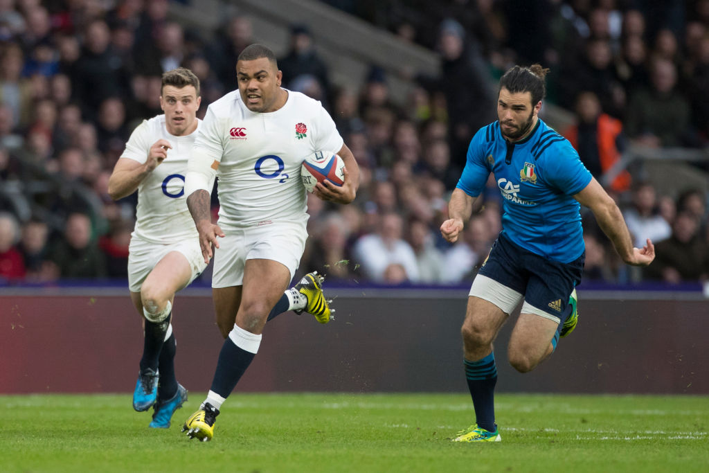 Kyle Sinckler of England (centre) charges forward during the RBS 6 Nations match between England and Italy at Twickenham Stadium on Sunday the 26th of February  2017 (Photo by Kieran Galvin/NurPhoto via Getty Images)