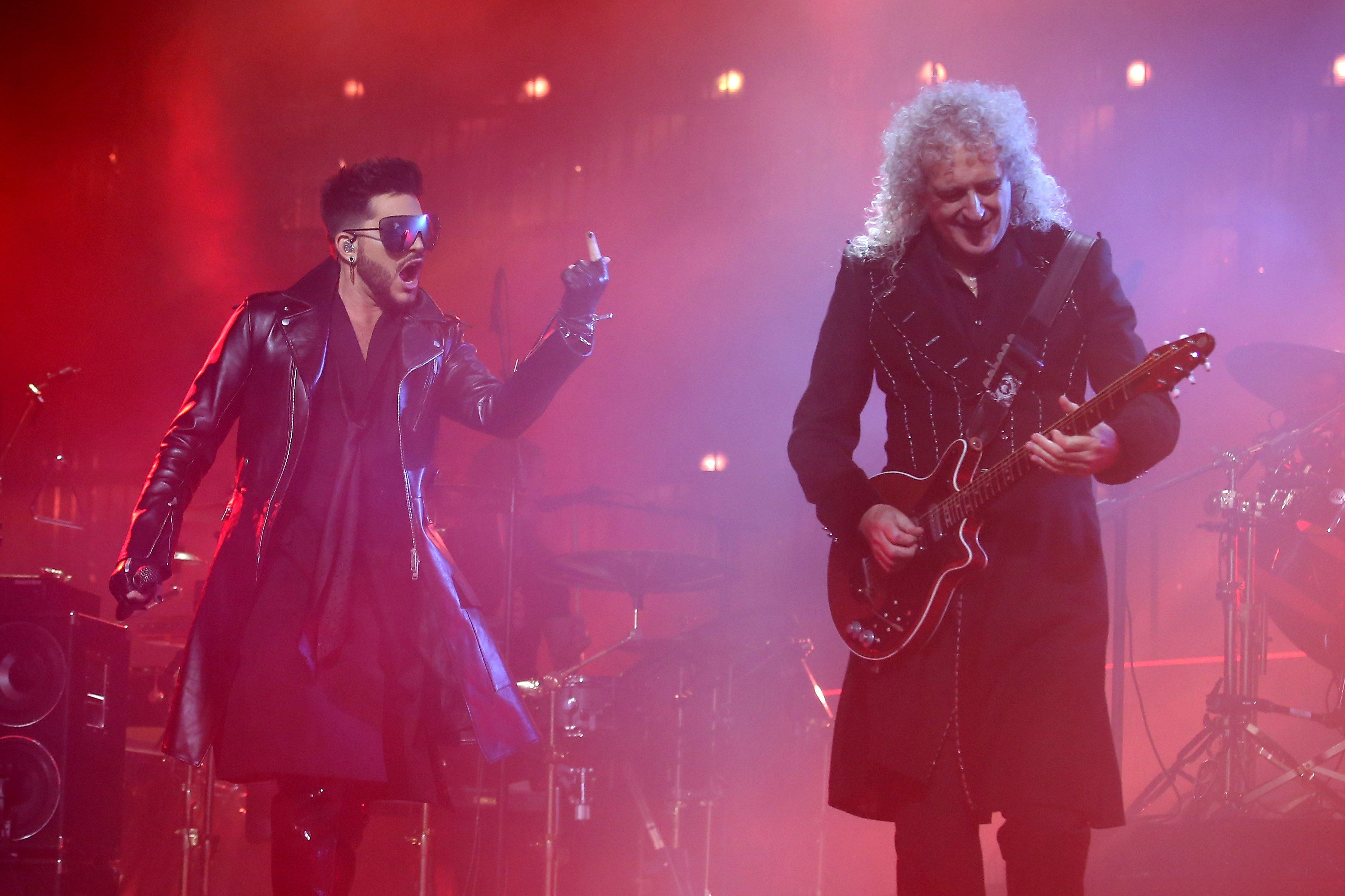 Adam Lambert and Brian May of Queen perform live on stage at The O2 Arena on December 12, 2017