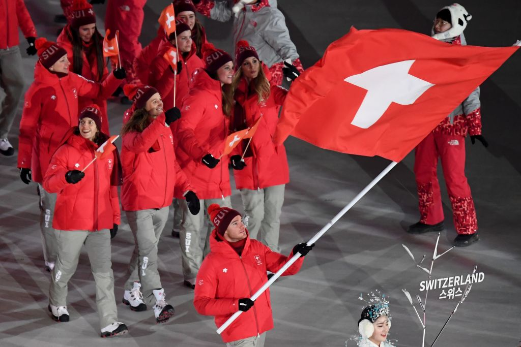 Switzerland's flagbearer Dario Cologna leads his delegation as they parade during the opening ceremony of the Pyeongchang 2018 Winter Olympic Games at the Pyeongchang Stadium on February 9, 2018. / AFP PHOTO / POOL / FRANCK FIFE        (Photo credit should read FRANCK FIFE/AFP/Getty Images)