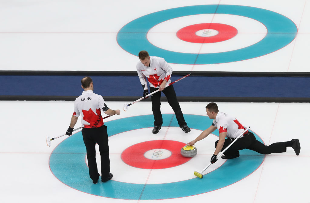 GANGNEUNG, SOUTH KOREA - FEBRUARY 15: Ben Hebert of Canada delivers a stone compete during the Curling Men's Round Robin Session 3 held at Gangneung Curling Centre on February 15, 2018 in Gangneung, South Korea. (Photo by Robert Cianflone/Getty Images)