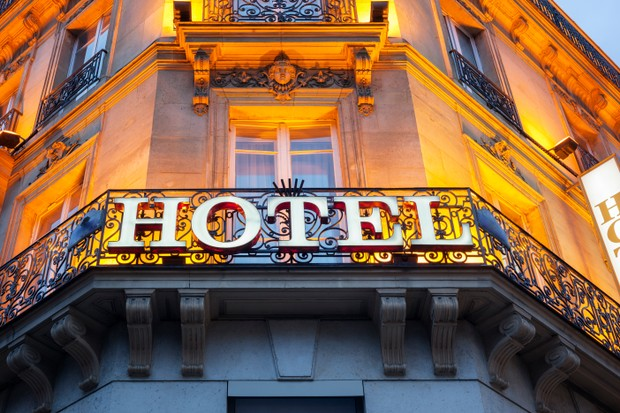 Illuminated hotel sign taken in Paris at night