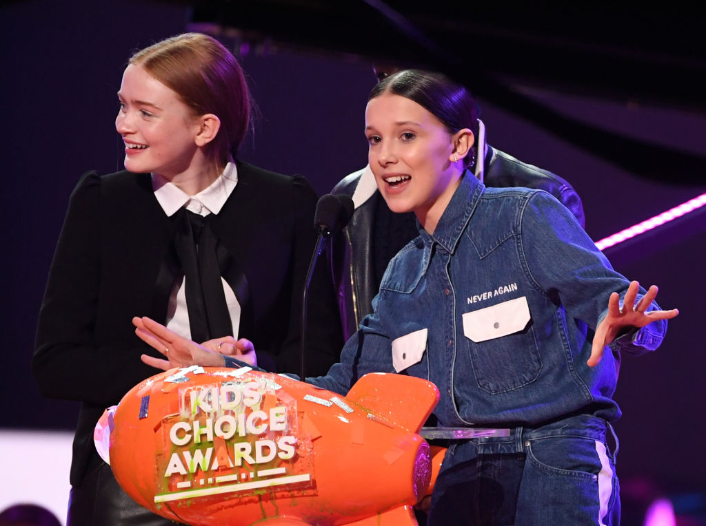 INGLEWOOD, CA - MARCH 24:  Sadie Sink (L) and Millie Bobby Brown speak onstage at Nickelodeon's 2018 Kids' Choice Awards at The Forum on March 24, 2018 in Inglewood, California.  (Photo by Kevin Winter/Getty Images)