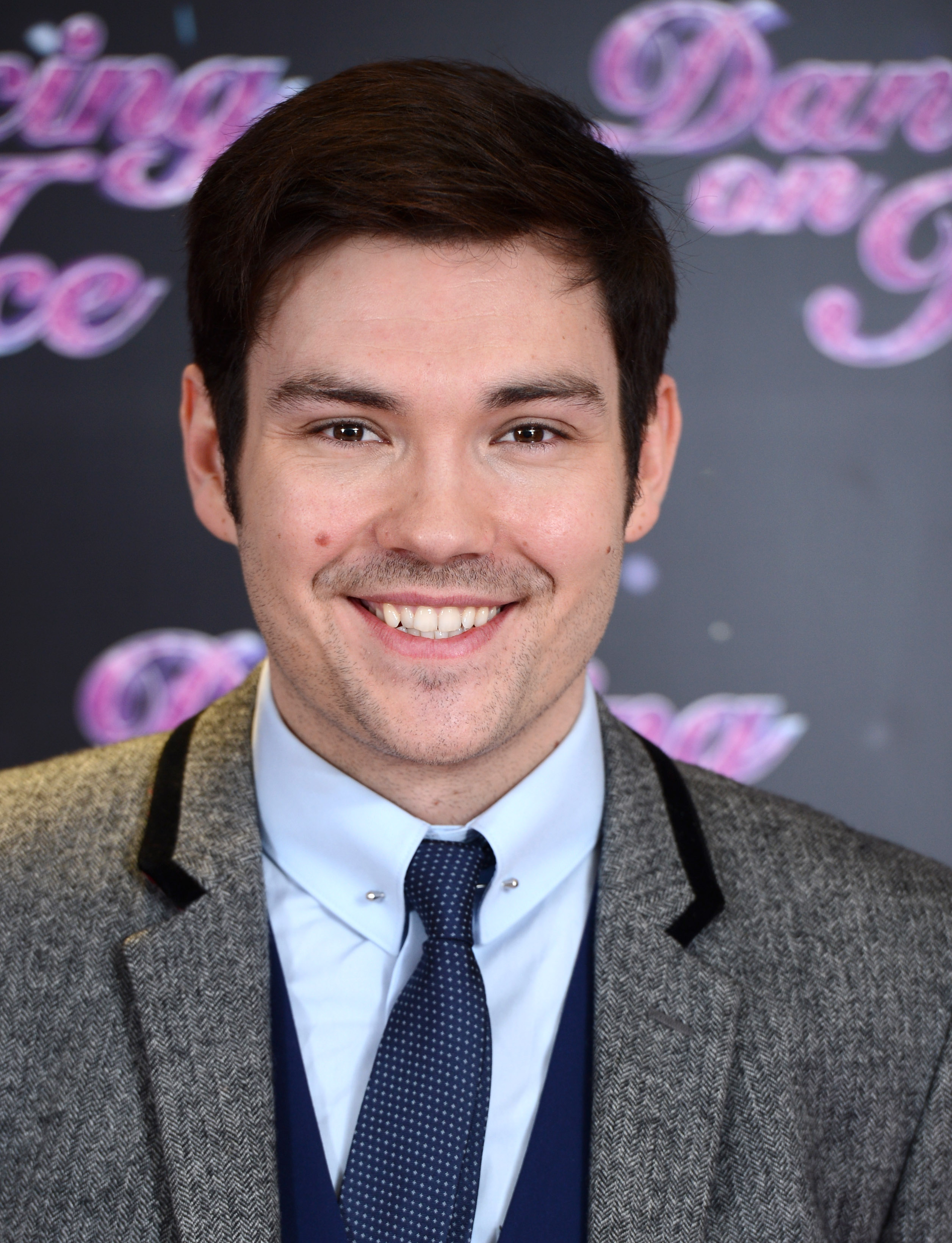"""LONDON, ENGLAND - JANUARY 02: Sam Attwater attends the series launch photocall for """"Dancing on Ice"""" held at the London Studios on January 2, 2014 in London, England. (Photo by Karwai Tang/Getty Images)"""