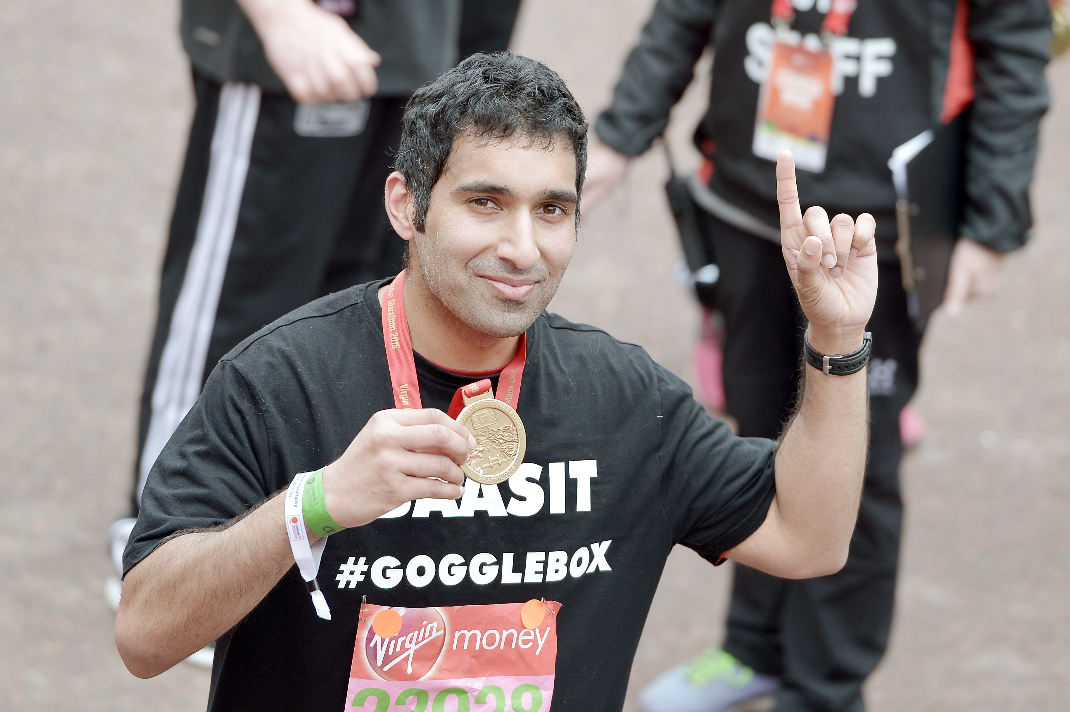 LONDON, ENGLAND - APRIL 24: Baasit Siddiqui poses with his medal after completing the Virgin Money London Marathon on April 24, 2016 in London, England. (Photo by Jeff Spicer/Getty Images)