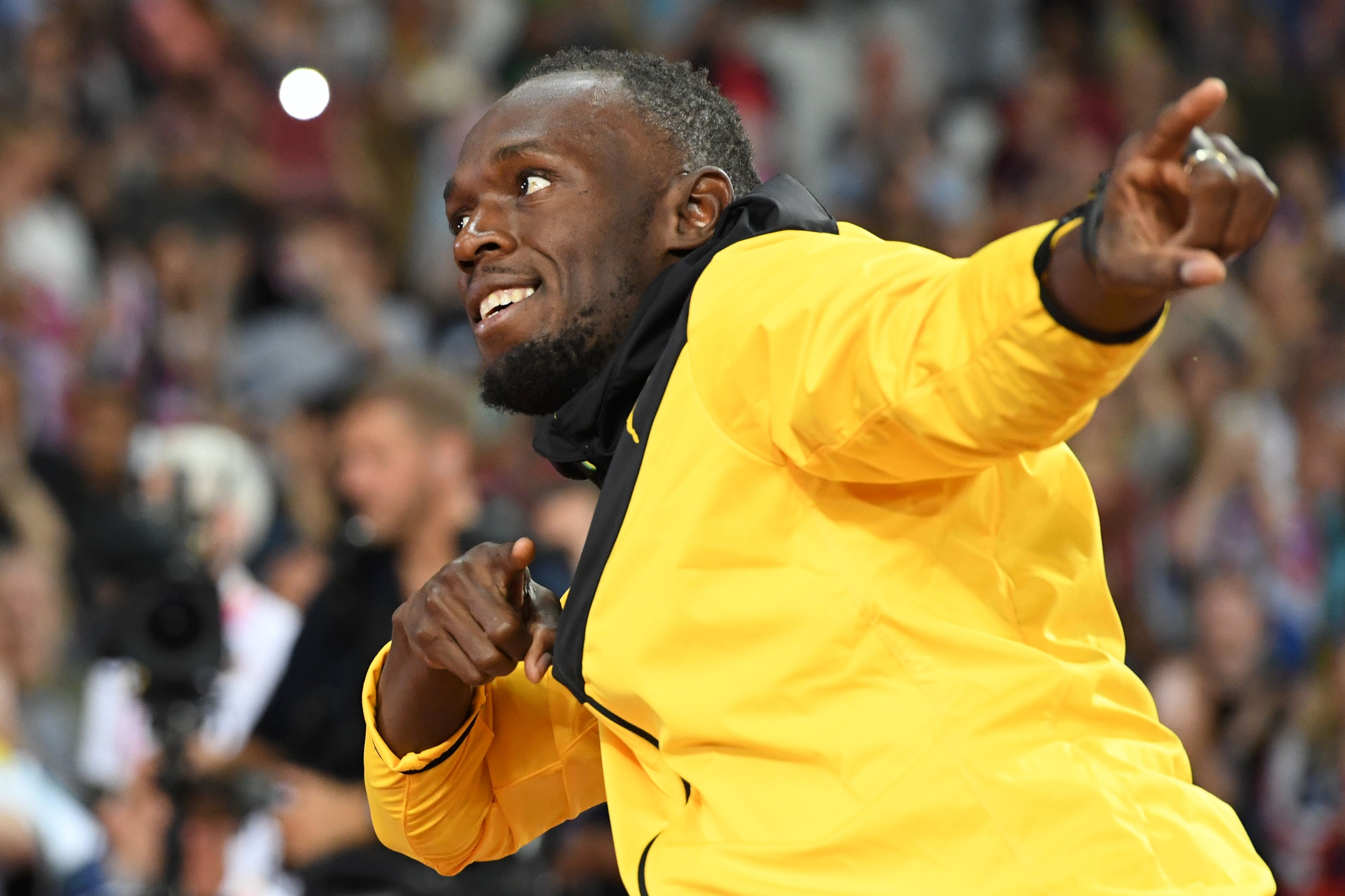 Jamaica's Usain Bolt takes part in a lap of honour on the final day of the 2017 IAAF World Championships at the London Stadium in London on August 13, 2017. / AFP PHOTO / Kirill KUDRYAVTSEV        (Photo credit should read KIRILL KUDRYAVTSEV/AFP/Getty Images)  Getty, TL