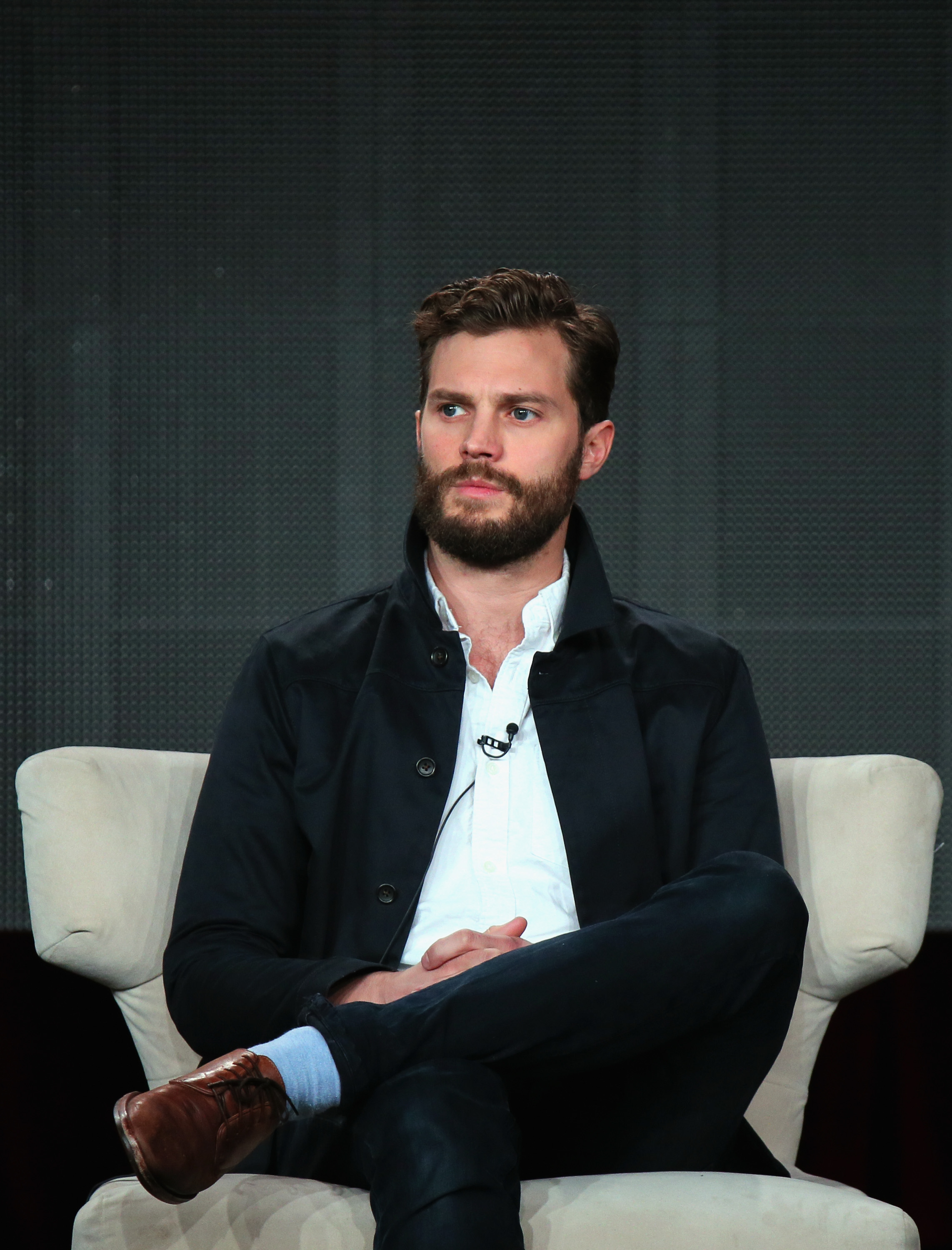 PASADENA, CA - JANUARY 07:  Jamie Dornan speaks onstage about The Fall during the Netflix TCA Press Tour at Langham Hotel on January 7, 2015 in Pasadena, California.  (Photo by Mark Davis/Getty Images for Netflix)  Getty, TL