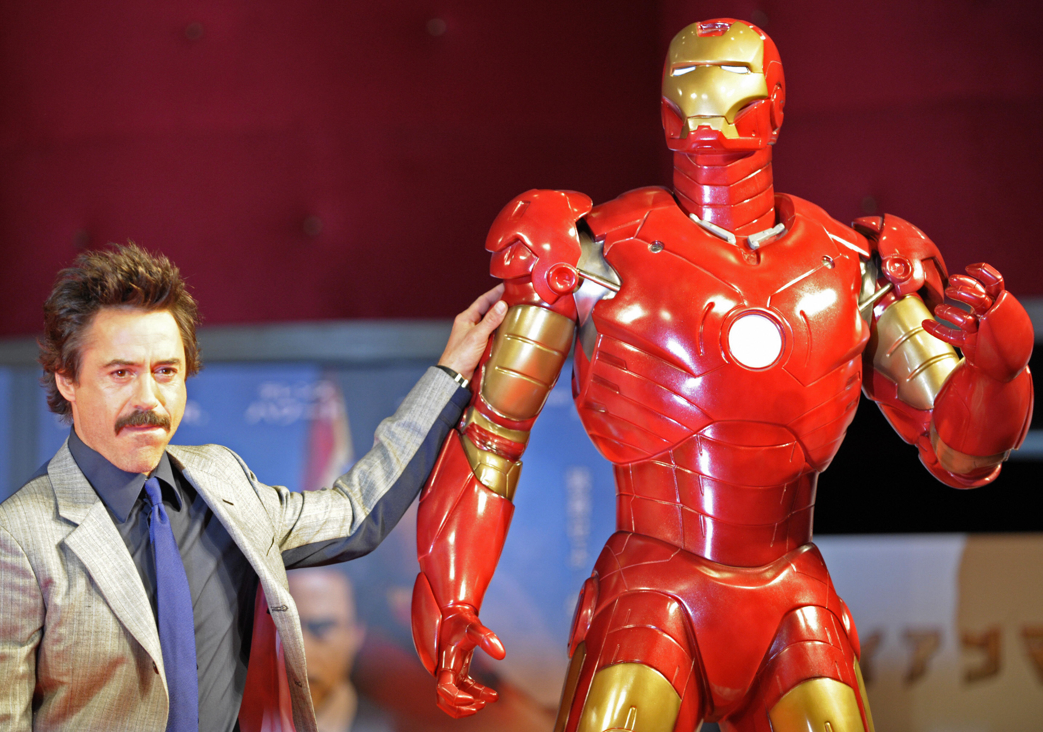 US actor Robert Downey Jr. poses by a life-size Iron Man model during a press conference on his latest movie Iron Man, in Tokyo, on September 3, 2008. The movie will roadshow in Japan from September 27.   AFP PHOTO / TOSHIFUMI KITAMURA (Photo credit should read TOSHIFUMI KITAMURA/AFP/Getty Images)
