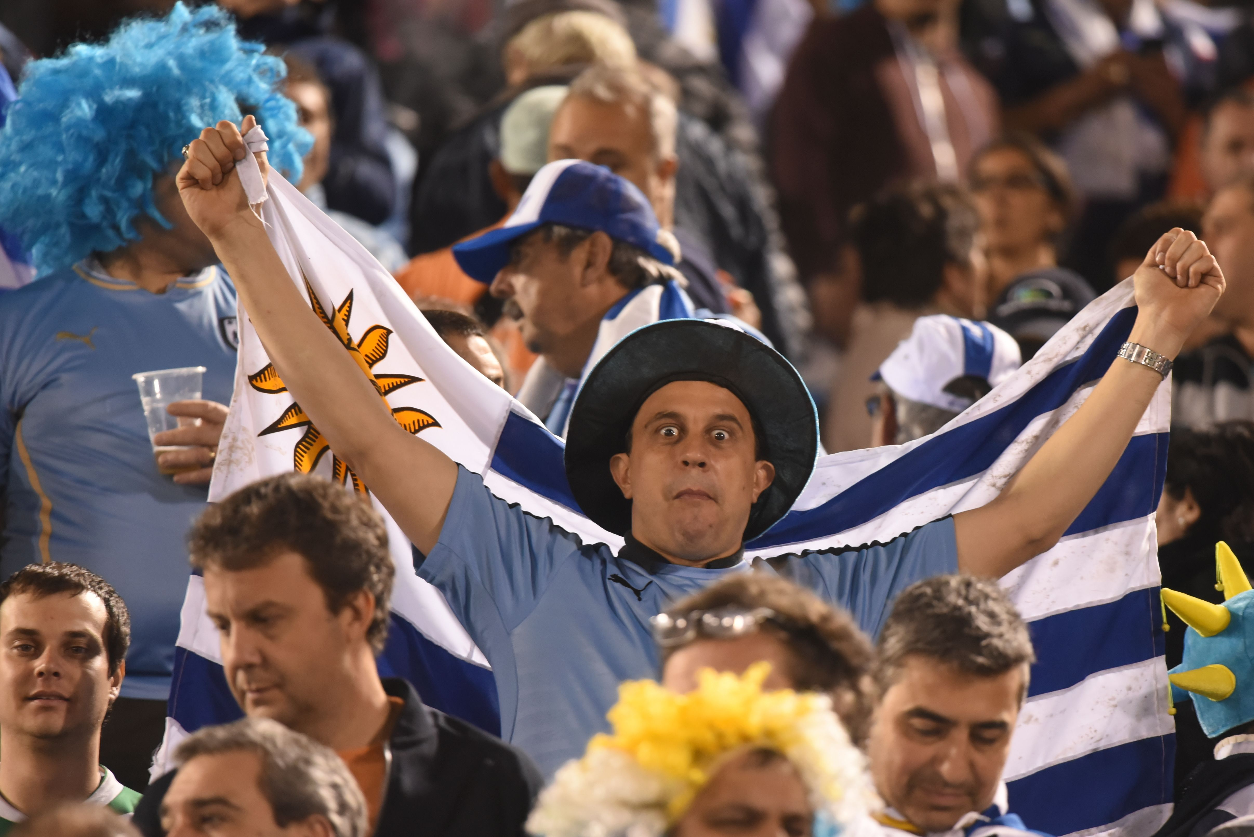 A supporter of Uruguay waits for the start of the 2018 World Cup football qualifier match between Paraguay and Uruguay in Asuncion, on September 5, 2017. / AFP PHOTO / FAVIO FALCON        (Photo credit should read FAVIO FALCON/AFP/Getty Images)