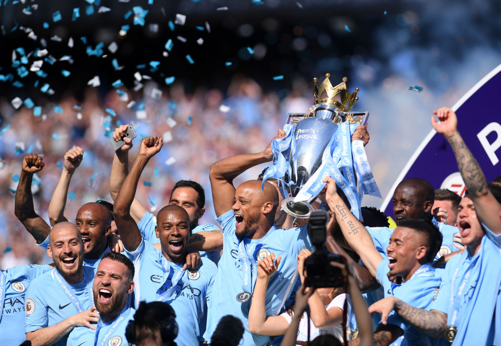 MANCHESTER, ENGLAND - MAY 06:  Vincent Kompany of Manchester City lifts the Premier League Trophy as Manchester City celebrate winning the Premier League Title during the Premier League match between Manchester City and Huddersfield Town at Etihad Stadium on May 6, 2018 in Manchester, England.  (Photo by Laurence Griffiths/Getty Images)