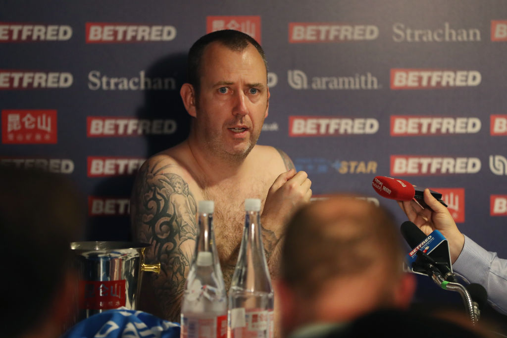 Mark Williams of Wales speaks to the media naked during a press conference after winning the World Snooker Championship 2018 (Getty)