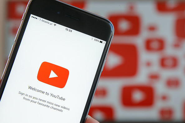 The YouTube video app is seen on various digital devices on 28 March, 2017. (Photo by Jaap Arriens/NurPhoto via Getty Images)