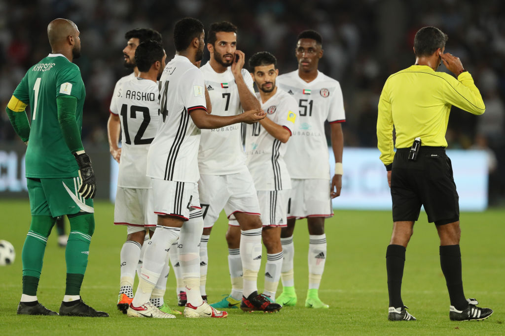 Referee Sandro Ricci refers a decision to a video replay during the FIFA Club World Cup UAE 2017 semi-final (Getty)
