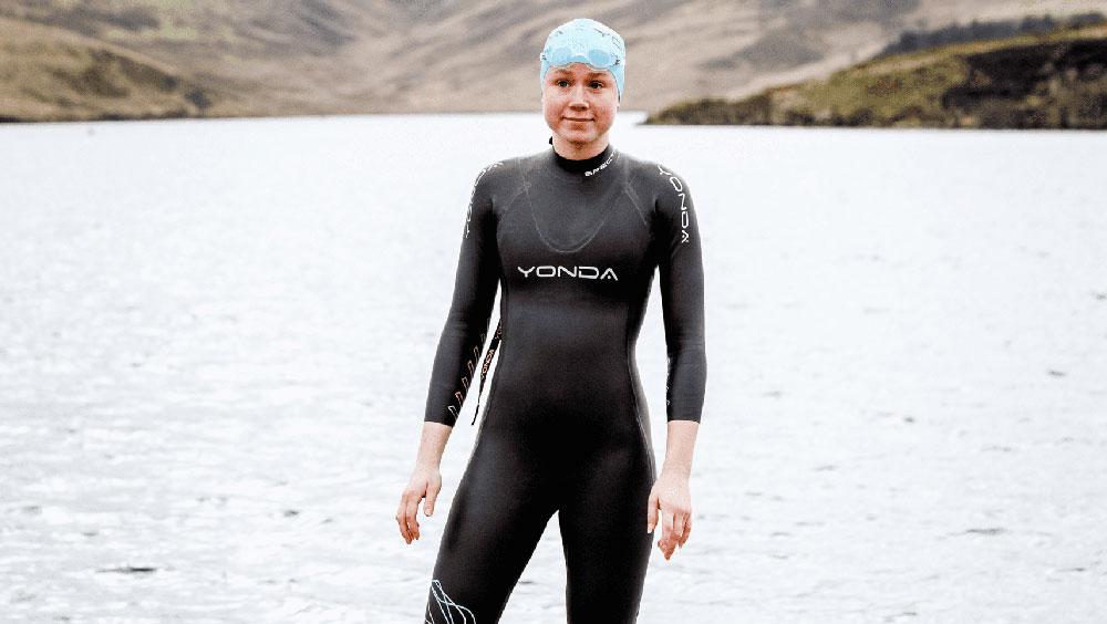 A lady wearing a Yonda wetsuit