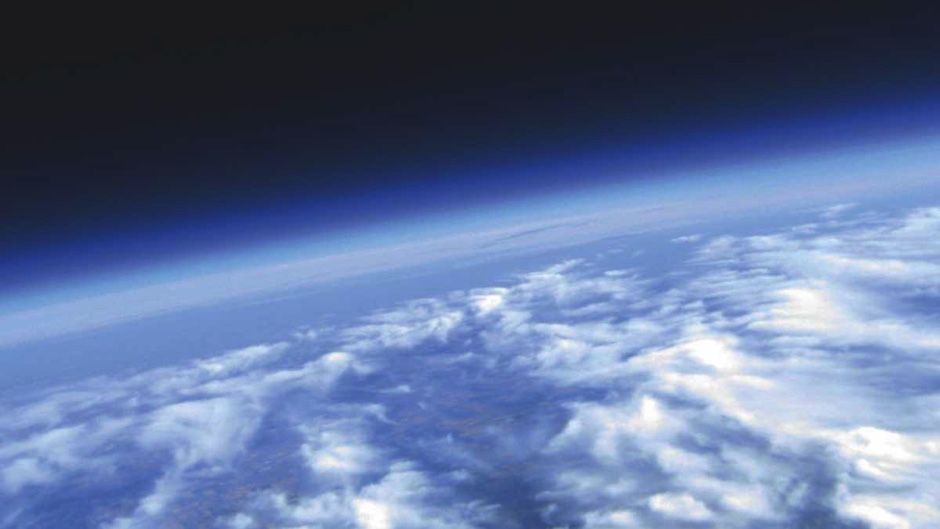 How much does Earth's atmosphere weigh?