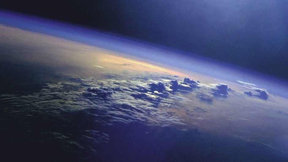 Why doesn't Earth's atmosphere vanish into the vacuum of space?