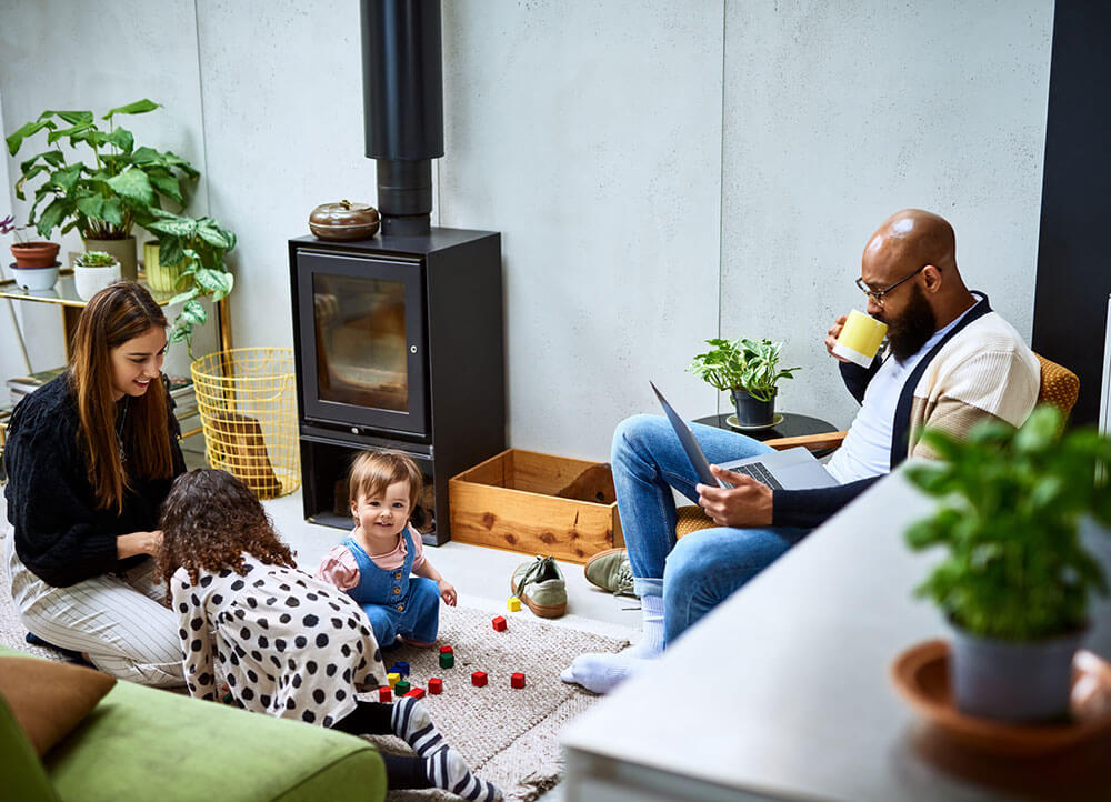 A family of four in a living room