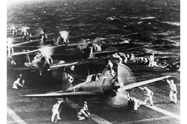 A Japanese photograph shows Mitsubishi dive bombers warming up on the deck of a carrier in the Pacific before their attack on Pearl Harbor in the early hours of 7 December 1941. (Photo by Corbis via Getty Images)