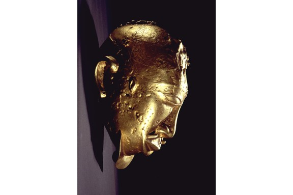A gold head, thought to represent the head of an important enemy killed in battle, from the Asante kingdom. The abundance of this precious metal greatly shaped the region's history. (Werner Forman/Universal Images Group/Getty Images)