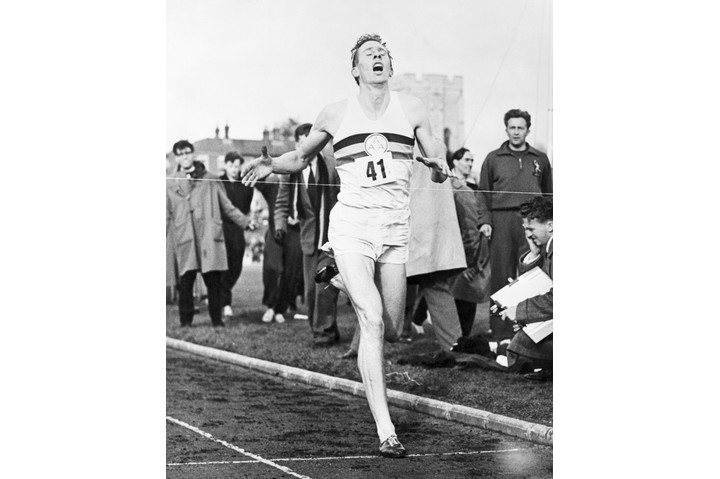 (Original Caption) 5/8/1954-Oxford, England: Mouth wide open gasping in air, with every tendon tight as a fiddle string, 24-year-old English medical student Roger Bannister is shown here breasting the tape and crashing his way into athletic history by completing the mile in 3 minutes 59.4 seconds at Oxford. He is the first man in history to run the mile and demolish the four minute barrier. BPA2 #1916