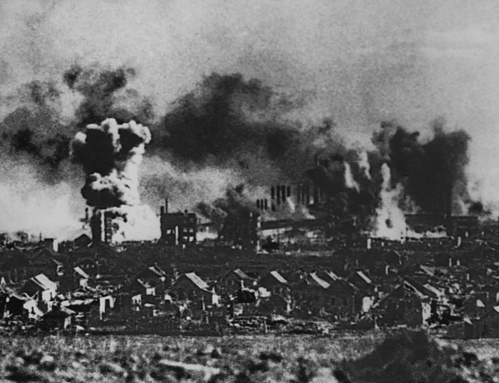 The battered city of Stalingrad undergoes artillery fire during its siege by German forces in 1942 and 1943. (Photo by © CORBIS/Corbis via Getty Images)