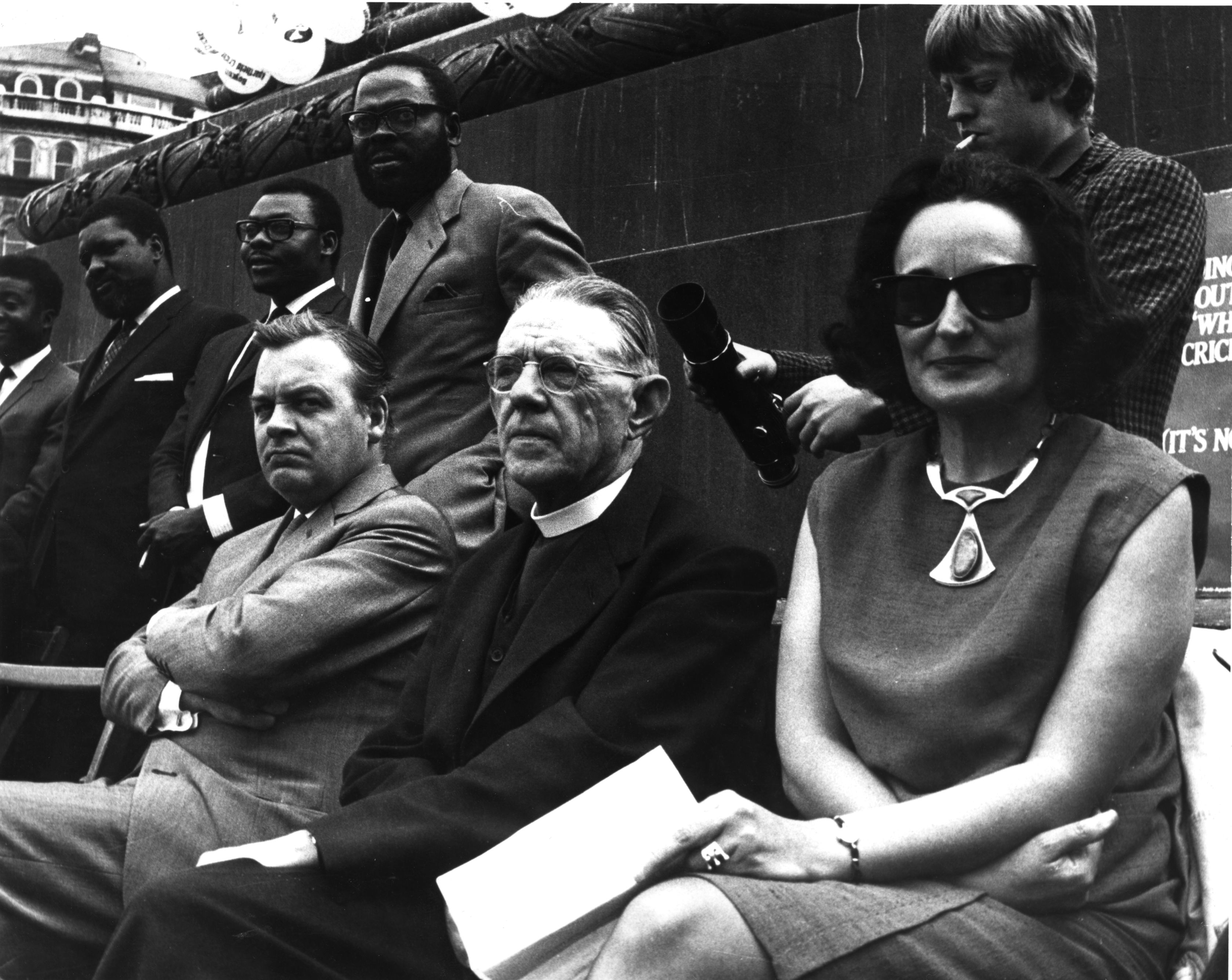 Journalist Ruth First, pictured right, at Anti-Apartheid Movement's freedom day rally in Trafalgar Square, London in 1965. Also pictured are actor Patrick Wymark (left) and Bishop Reeves (middle). (Photo by Keystone/Getty Images)