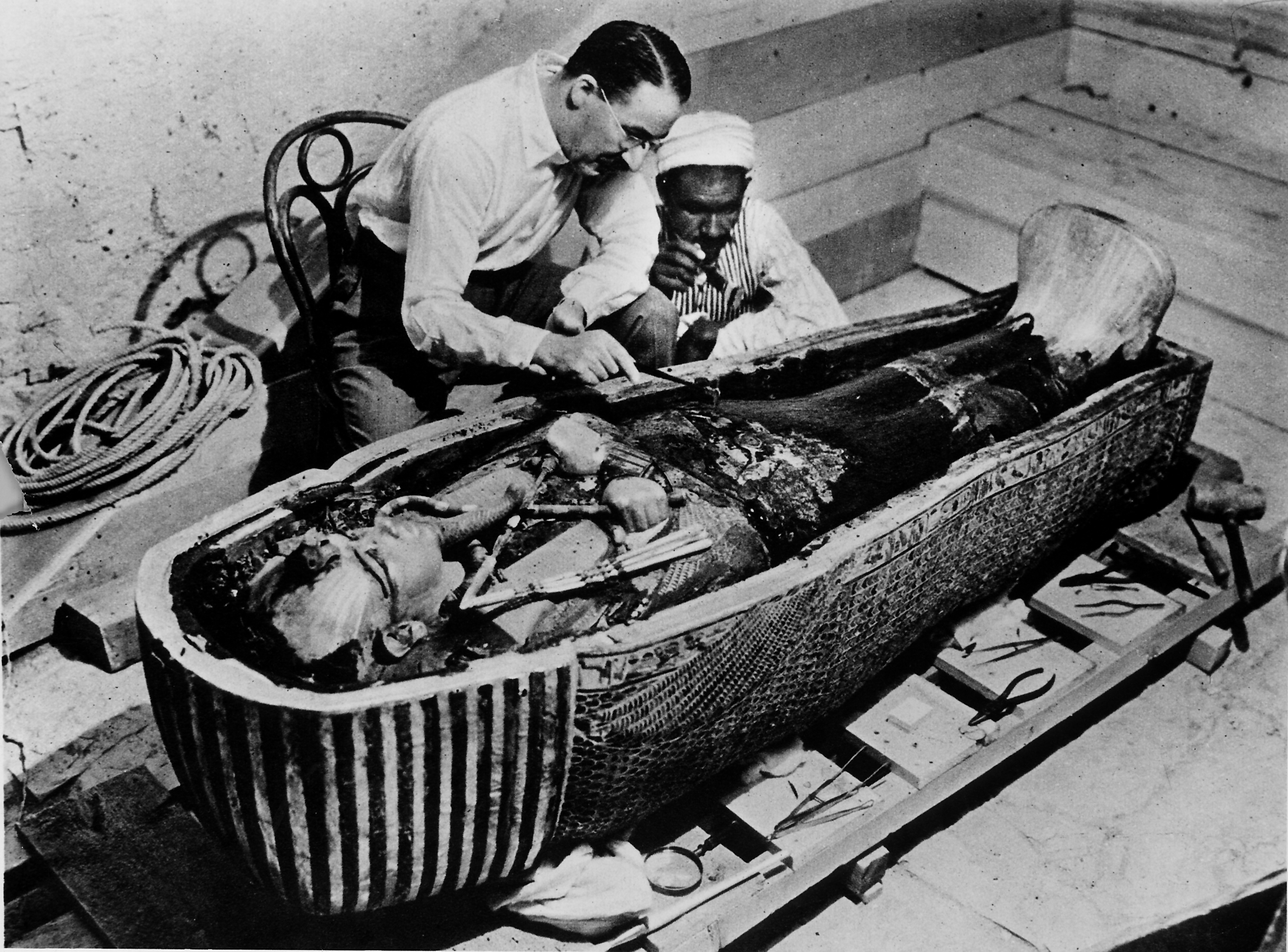 Archaeologist Howard Carter removing oils from the