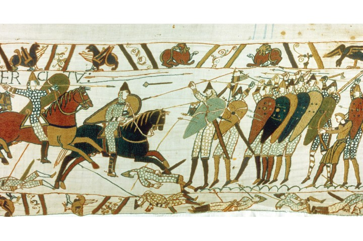 A section of the Bayeux Tapestry depicting the battle of Hastings. Anglo-Saxon foot soldiers are seen defending themselves with a wall of shields against Norman cavalry. (Photo by Photo12/UIG via Getty Images)