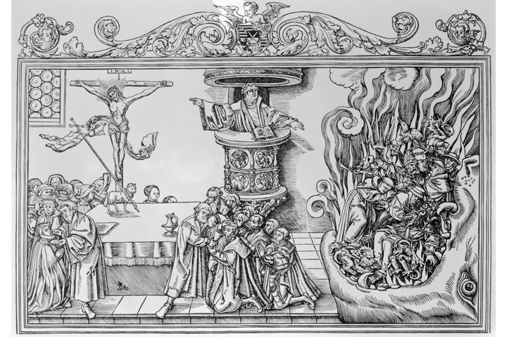 Martin Luther (centre) preaching. With one hand he points to popes, monks and cardinals going down the mouth of hell; with the other he points to the crucifix. (Getty Images)