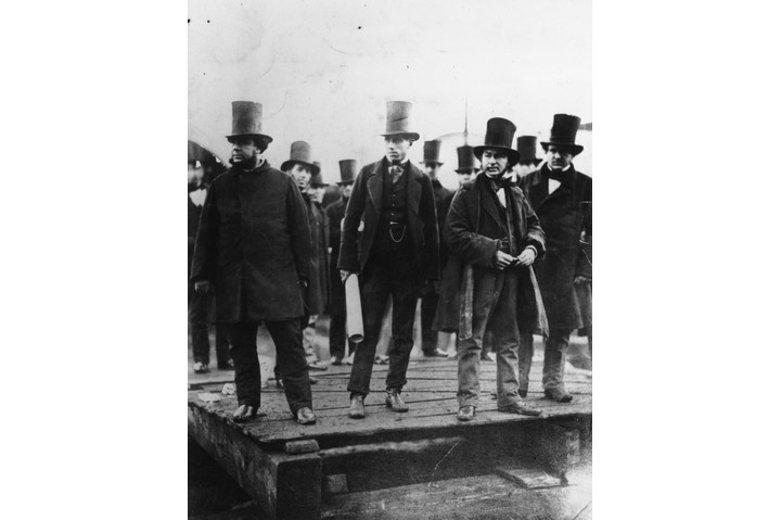 From left to right; Engineers John Scott Russell, Henry Wakefield, designer Isambard K Brunel and Lord Derby at the first launching ceremony of the Great Eastern ship. Scottish naval architect and civil engineer John Scott Russell (1808 - 1882) was born in Parkhead in Glasgow and graduated from the University there aged 13. He had considered a religious career but his fascination with steam and design inspired him to set up a coach company instead. Unfortunately in 1834 he became responsible for the first fatal automobile accident in Scotland in which four passengers died. This ended his business and he turned to ship design instead, pioneering experimental wave-line vessels for the Union Canal Company and, with Brunel, making the steamer 'Great Eastern' possible despite its size. He also worked as a journalist specialising in railway articles and owned his own shipyard. (Photo by Robert Howlett/Getty Images)