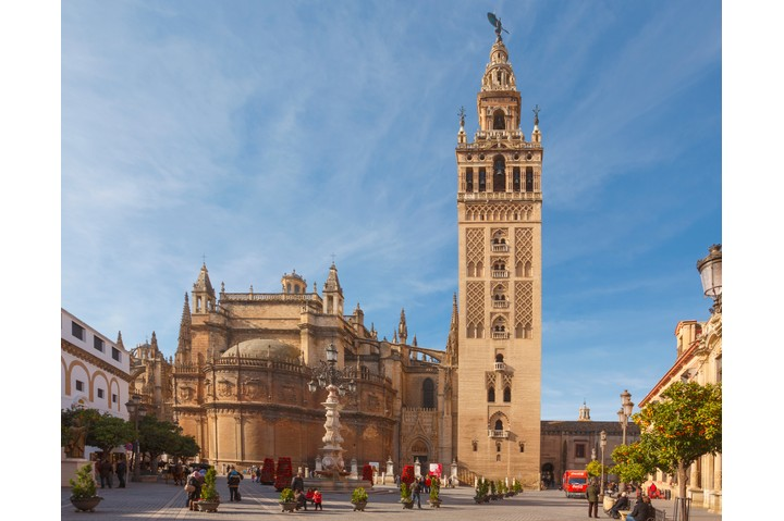 The Giralda tower and cathedral seen across the Plaza de la Alianza, Seville, Spain. (Getty Images)