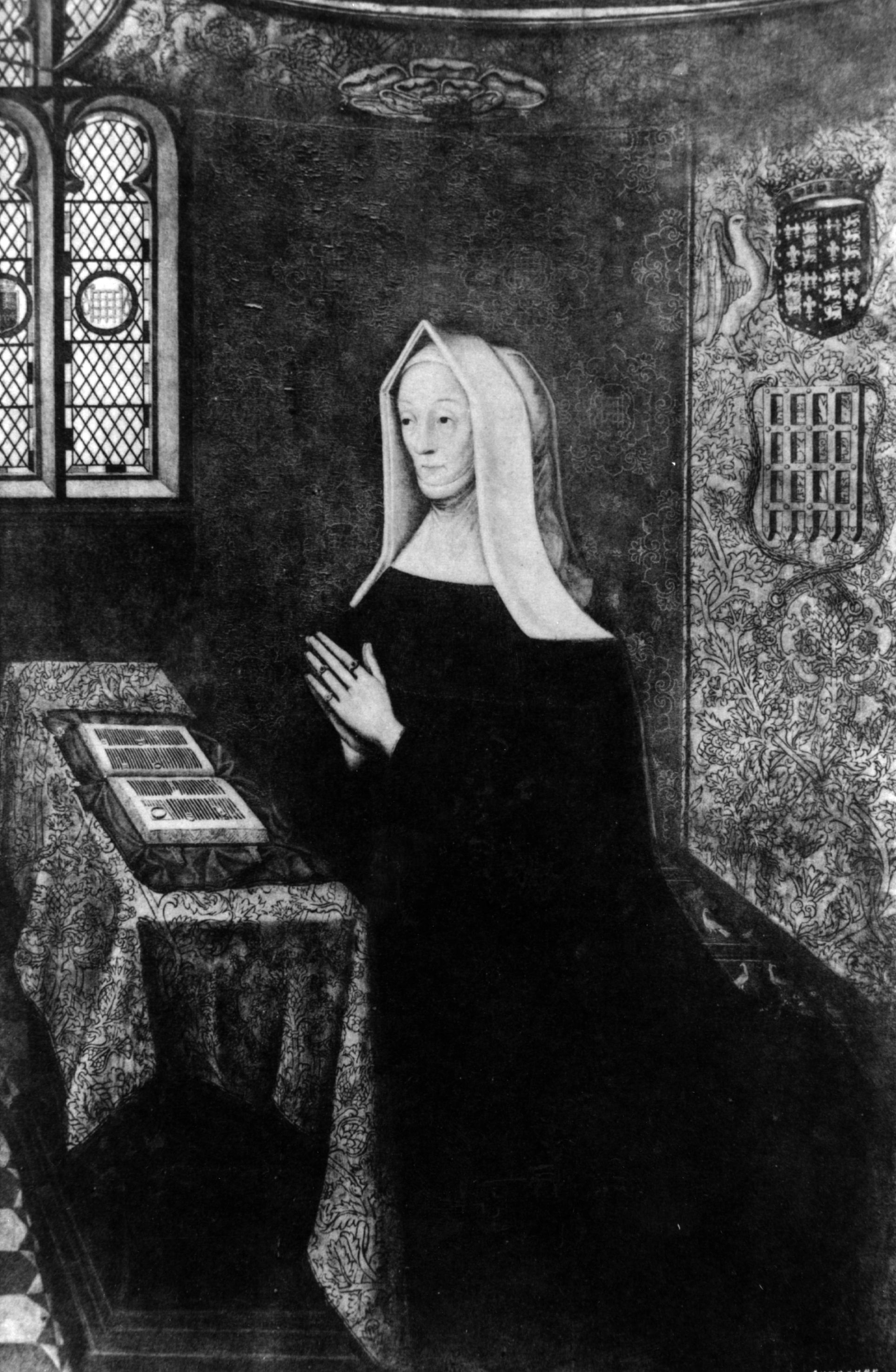 Margaret Beaufort, mother of Henry VII, seen on her knees in prayer wearing a nun-like head covering. (Photo by Hulton Archive/Getty Images)