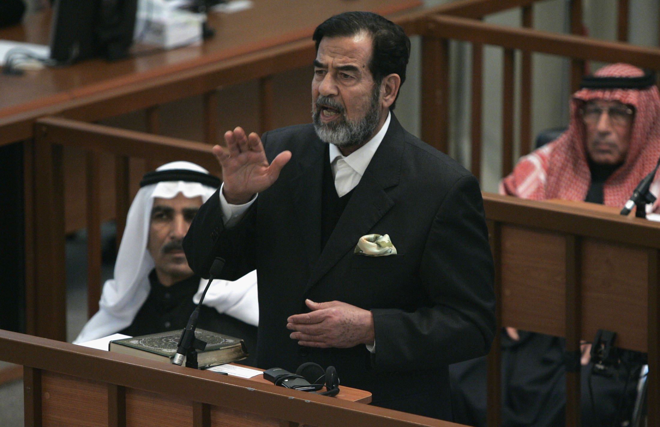 Former Iraqi president Saddam Hussein on trial in December 2008 in Baghdad, Iraq. (Photo by Nikola Solic-Pool/Getty Images)