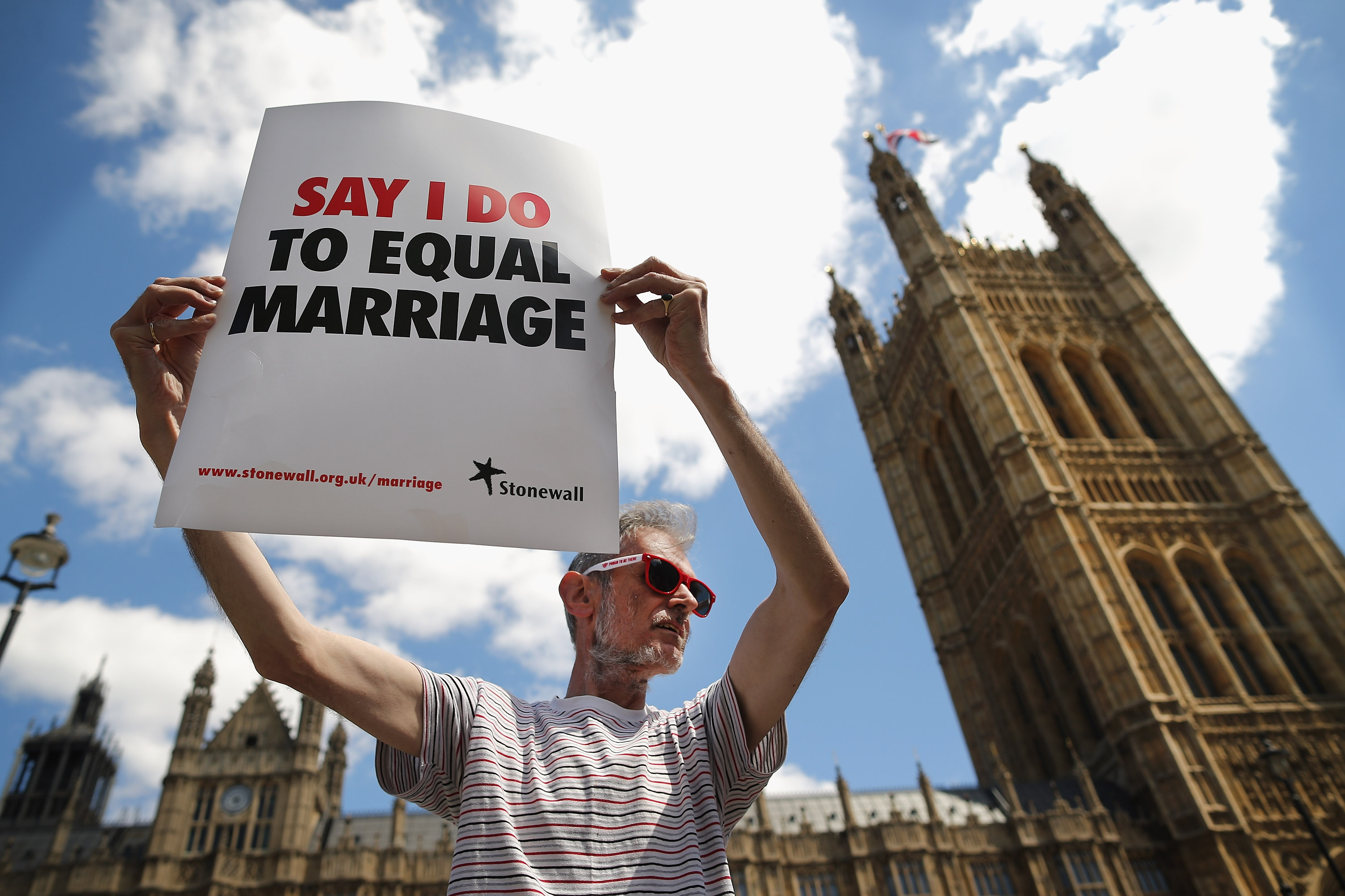 A proponent of same-sex marriage protests outside the Houses of Parliament, 3 June 2013. (Photo by Dan Kitwood/Getty Images)